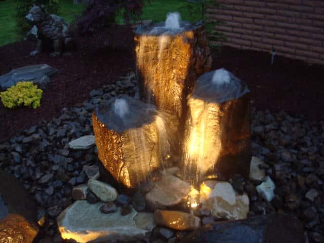 Concrete Works Statuary Inc 3 Piece Medium Triad at night